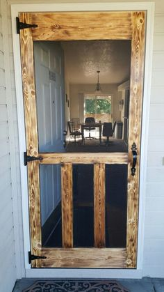 25 different ways to build yourself a new screen door or upcycle an old one. great diy screen door ideas to inspire your creativity. Farmhouse Decor, Decor, Home Diy, Diy Screen Door, Wood, Rustic House, Home Improvement, Home Projects, Rustic Home Decor