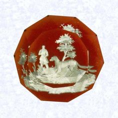 Morton D. Barker Paperweights: Paperweight Gallery:Top -- Illinois State Museum Sulphide Hunter & Dog Baccarat ca 1845-55 Translucent red footed base, sides cut w/facets 10sided facets cut on top...