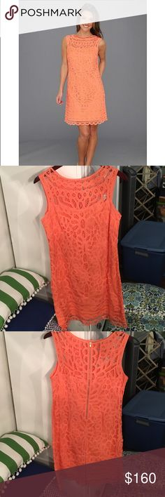 "Lilly Pulitzer Tabitha Shift Dress This beautiful Lilly Pulitzer dress is authentic and so pretty! The intricate lace pattern is beautiful and it is ""Sunset Orange."" Gold zipper up the back. I only wore this dress once for about 3 hours and it has just been sitting in my closet. Perfect condition! Lilly Pulitzer Dresses"