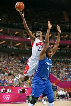 American Sylvia Fowles goes up for a shot against France's Isabelle Yacoubou