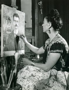 Frida Kahlo painting the portrait of her father, 1951, Photograph : Gisèle Freund Museos Diego Rivera y Frida Kahlo.. One heck of talent and of a woman!
