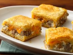 Sausage Squares 2 pk crescent rolls 1-2 c cheddar cheese, sh 8 oz cream cheese 1 lb. ground maple sausage  1. Brown meat. Meanwhile, layer 1 pk crescents on bottom of 13x9 baking dish. 2. Drain sausage. In a med. bowl combine sausage & cream cheese. Spread over crescent rolls. 3. Sprinkle cheese over top. 4. Cover with remaining crescent rolls. 5. Bake according to rolls directions.