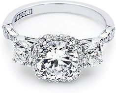 Tacori 3 Stone Twist Diamond Engagement Ring 542CU - If you love the Tacori Dantela Collection, you will fall in love all over again with this three stone stunner! A single stand of diamonds surrounds the center creating a bloom adding even more romance to this sparkling beauty. Iconic crescent design decorates the profile of this ring allowing windows of light to shine through from every angle.