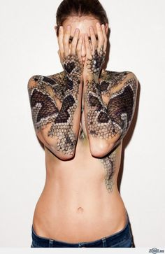 this is a tattoo, but i think you could do this with makeup and a fishnet stocking for a scale pattern