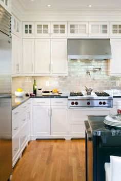 Chunky crown molding + upper glass cabinetry = good solution for high ceilings in the kitchen. The backsplash isn't bad either :)