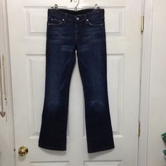 7 for all mankind boot cut dark blue jeans sz 27 In great condition dark wash bootcut jeans, inseam 30 7 for all Mankind Jeans Boot Cut