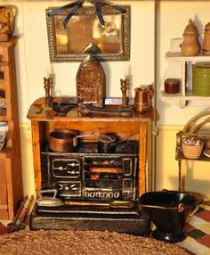 """Built-in metal range was part of a set (""""Monster Kitchen Set"""": stove, dresser, table, chairs, plate and frying pan, all metal), made in England by Hopkins Bros., Victoria Tin Toy Works, London, and advertised in 1927. This type of range, however, had been in use for many years. It was more popular at an earlier date in Britain, than in North America, because of the prevalence of coal."""