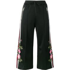 Gucci embroidered cropped track pants ($1,600) ❤ liked on Polyvore featuring pants, capris, black, calf length pants, embroidered pants, gucci, mid calf pants and gucci pants