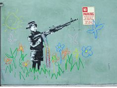 Completed by Banksy in Westwood, California in 2011, this little boy is shooting crayons instead of bullets.