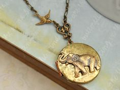BEST OF FRIENDS baby elephant and sparrow bird vintage locket necklace antiqued brass long chain on Etsy, $32.50