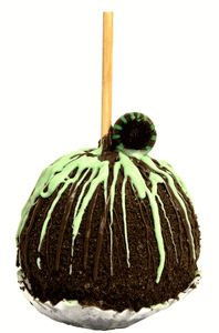 This caramel apple is covered in mint flavor dark chocolate then rolled in Oreo® cookie crumbs.  It is finished off by drizzling in more mint chocolate, garnished with a mint candy.