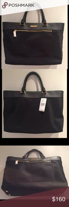 "Michael Kors Colgate black tote 👜 large MICHAEL KORS COLGATE LARGE EAST WEST TOTE BLACK NYLON WITH BLACK SAFFIANO LEATHER TRIM  RETAIL $228  - Soft nylon trimmed with leather  Gold-tone hardware  Exterior front zipped pocket  Four protective feet  Interior lined with signature nylon  Interior has a middle, padded, zipped compartment along with a zipper pocket, cellphone pocket and 2 slip pockets  Measures: 16.5"" L x 11"" H x 7"" D Handle drop: 5""  Detachable cross body strap drop: 26"" Michael…"