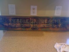 Hand painted and distressed pebble beach sign