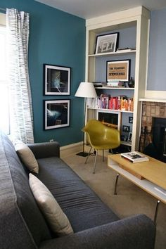loving the teal wall behind the bookcase too..... mmmm..... considering for my lounge room with hot pink carpet and yellow accents!