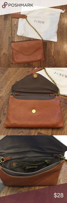 J Crew 100% real leather clutch/purse NWOT Beautiful!! 100% Real Leather! I never used it.  Chain strap.  Can be used as a clutch or purse.  Several different compartments for storing makeup, cell phone, wallet, etc.  One flaw a small brown mark on the front of purse as seen in close up photo as well as very minor scratches.  Comes with J Crew tote as well (seen in pics). J. Crew Bags Clutches & Wristlets