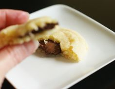 Nutella and sea salt stuffed sugar cookies. - take this idea and use a chunk of chocolate instead.  yum!