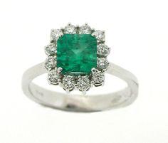 Anello in oro 18 kt con 12 Diamanti naturali Certificati e 1 Smeraldo colombiano