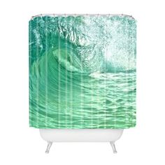 I'm really diggin all their shower curtains. Tumble Wave Shower Curtain from Dot and Bo
