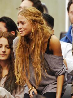 Mary-Kate Olsen. Boho hair, off the shoulder slouchy top