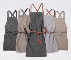 Our Fight the Fade high quality aprons are lightweight yet durable; resisting fading for over 100 washes. Designed to perform to the highest standards in cafes, restaurant and retail workplaces. Waiter Uniform, Spa Uniform, Uniform Shop, Chef Dress, Apron Dress, Restaurant Uniforms, Shop Apron, Work Uniforms, Uniform Design