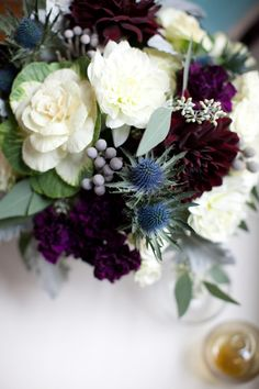 gorgeous arrangement with thistle, brassica cabbage blossoms, dahlia, and silver brunia
