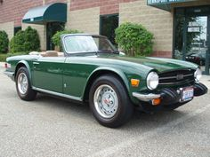 1976 Triumph TR6 in British racing green.