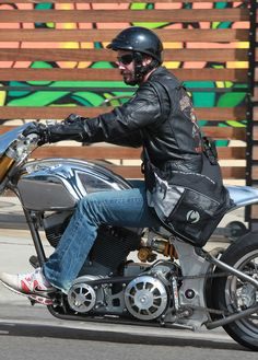 'Ronin 47' actor Keanu Reeves sports his Harley Davidson jacket while running errands on his silver motorcycle in Los Angeles, CA on October 5th, 2012.