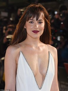Dakota Johnson rocks EXTREMELY plunging gown at Fifty Shades premiere #dailymail