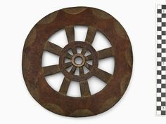 Culture/People:Cowichan  Object name:Spindle whorl  Date created:1870-1900  Place:Duncan; Cowichan Valley Regional District; British Columbia; Canada  Media/Materials:Hardwood, ochre  Techniques:Carved, painted