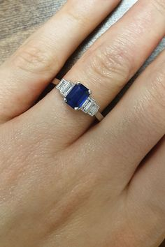 This blue sapphire engagement ring is based on a classic Art Deco design, originating from the 1920s. The centre sapphire is emerald-cut and on either shoulder, two baguette cut diamonds have been set into a rub-over and millegrained collet. The ring has a flat profile band which means it will sit comfortably against a flat profile wedding ring. #LondonVictorianRing #BlueSapphireRing #SapphireRing #SapphireEngagementRing #BlueGemstone #BaguetteDiamond Emerald Cut Sapphire Ring, Sapphire Wedding Rings, Art Deco Wedding Rings, Sapphire Engagement Rings, Wedding Band, Dream Wedding, Flat Engagement Rings, Baguette Engagement Ring, Baguette Diamond Rings
