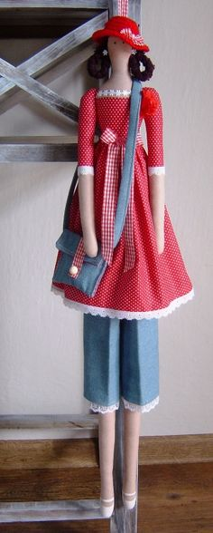 Tilda in red & blue, purse, hat.