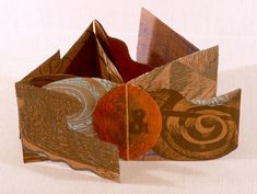 """O & by Karen Kunc.   1991  bookwork: woodcut, intaglio and letterpress on shaped paper  6.5 x 6.5"""""""