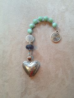 Handmade these pocket Anglican-Christian prayer beads using my late Mother's silver heart.  Reminds me of God's love and my sweet Mother's love.