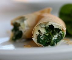 Spinach and feta roll-ups.Delicious oven baked appetizer with spinach,feta and greens. See More Delicious Recipes! Vegetarian Recipes, Cooking Recipes, Healthy Recipes, Delicious Recipes, Spinach And Feta, Chopped Spinach, Spinach Leaves, Crispy Rolls, Good Food