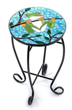 Palm Island Home Frog On Branch Mosaic Table by Palm Island Home. $27.99. Bealls Exclusive. Imported. A decorative piece of furniture! This colorful accent table features an exquisite mosaic frog design. Some assembly may be required. Measures 14'' x 23''. Glass.