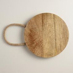 One of my favorite discoveries at WorldMarket.com: Round Wood Cutting Board with Rope Handles