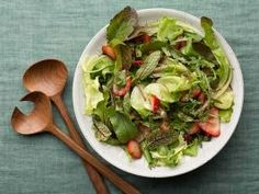 Green Salad with Strawberry Balsamic Vinaigrette : Rachael Ray's simple five-minute salad embraces the flavors of spring with fresh greens, strawberries and a sweet-tart vinaigrette.