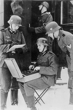 German radio men prepare to send a message encrypted on the Enigma machine.Enigma was a electro-mechanical rotor cipher machine invented toward the end of German Soldiers Ww2, German Army, World History, World War Ii, Enigma Machine, Germany Ww2, Ww2 Photos, Luftwaffe, War Machine