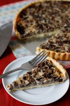 a creamy tart packed with earthy mushrooms, sitting atop a flakey, crispy cornmeal crust.