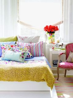 Bright colorful bedroom with mix of stripes and prints