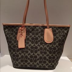 "Coach signature tote Coach signature brown soft vinyl tote with natural  leather trim & straps. Brand new with tags.% Authentic. Measures 15.5"" (w) X 9.5""(h) X 7""(d)    9""strap drop. Price is firm. Coach Bags Totes"