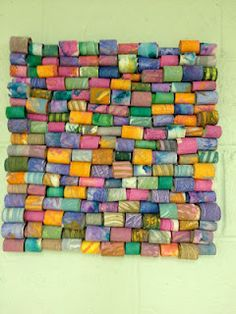 fun to re-create this with paper towel rolls and toilet paper rolls for group work...great for art show piece.