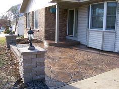stamped concrete front porch court yard area with seating wall and lights, st charles mo