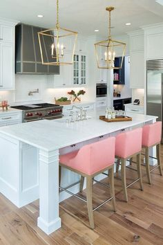 pink bar chairs, gold accents white kitchen