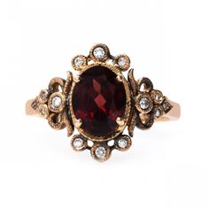 Dauphine   Claire Pettibone Fine Jewelry, Antique Garnet stone with 12 diamonds.  Rose Gold band.  Available from Trumpet and Hound.