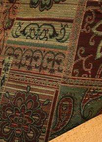 Arabian fabric is of the finest quality tapestry featuring Moroccan theme in rich colors of burgundy, tan, green and pinch of black. Eye catching cover will add elegance to any room.