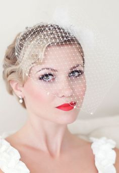 Love the look, minus the bright lipstick. I will have a birdcage veil like this one.