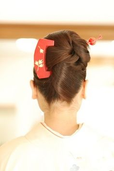 Formal complicated updo with hair pin and comb