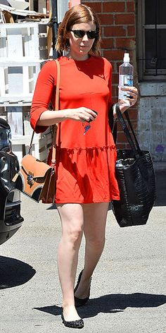 Love Her Outfit! Star Style to Steal   KATE MARA   Warmer weather has us all reaching for the brights in the back of our closet – but since it's not quite summer yet, we're loving the way Kate tempered her poppy-red drop waist dress with neutral, classic accessories.