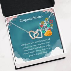 This necklace is a great way to show a special graduate how proud you are of their accomplishment of completing their engineering degree.The message card says: all of your hard work has payed off and you are now a engineer. Your determination will help you go far in your career. I know that you are going to do great things. #engineergraduategift #universitygraduationnecklace #giftforengineergraduation Graduation Necklace, Graduation Gifts, Double Heart Necklace, Two Hearts, Message Card, Working Moms, Hard Work, Determination, Congratulations